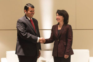 Maharashtra Chief Minister Devendra Fadnavis with Oracle CEO Safra Catz after signing a pact that will see the US company accelerate the state\'s digital transformation and develop a \'Smart City Center of Excellence\'.