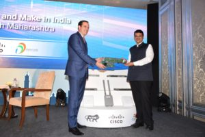 Maharashtra Chief Minister Devendra Fadnavis and Chuck Robbins, CEO, Cisco, launching the Cisco\'s Pune manufacturing unit, in Mumbai on October 12 (Photo: IANS)