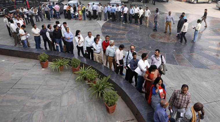 A large queue of people wait outside a bank to exchange Indian currency in the denominations of 1000 and 500 that have been declared to be of no value, in New Delhi, India, Friday, Nov. 11, 2016. Delivering one of India's biggest-ever economic upsets, Prime Minister Narendra Modi this week declared the bulk of Indian currency notes no longer held any value and told anyone holding those bills to take them to banks to deposit or exchange them. (Courtesy: AP Photo/Saurabh Das)